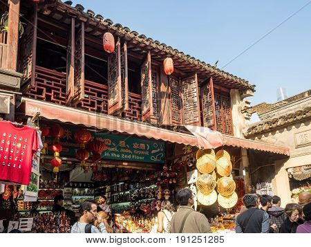 Shanghai, China - Nov 4, 2016: Around Yu Yuan (Yu Garden) - An old residential building with architectural structures designed in the traditional Chinese styling converted into a modern-day souvenir store.