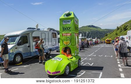 Pas de Peyrol France - July 62016: The Vehicle of Pressade during the passing of the Publicity Caravan on the road to Pas de Pyerol (Puy Mary) in Cantalin the Central Massif during the stage 5 of Tour de France on July 6 2016. Pressade is a French produce