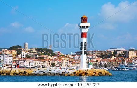 a panoramic view of the Vieux Port, the Old Port of Cannes, France, and Le Suquet district, the old town, in the background