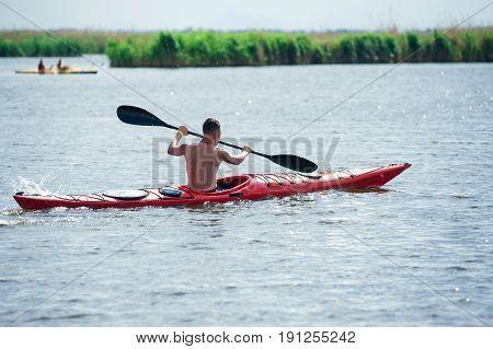 Man Swims On A Red Kayak 01