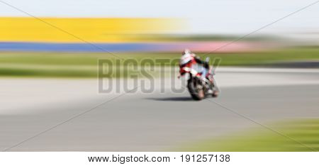 Abstract blurred background with copyspace. Blur motion of motorcycle racer on a track.