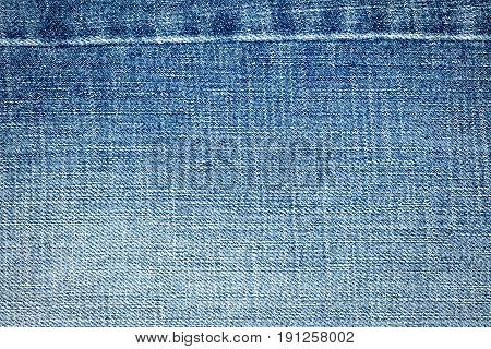 Light blue jeans texture. Denim jeans texture denim jeans background with a seam. Jeans fashion design.