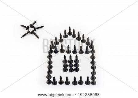 House And Sun Laid Out With Phosphated Black Screw Isolated On White Background