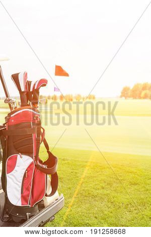 Golf club bag at golf course against clear sky