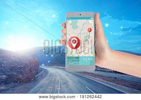 Travel apps concept. Woman using map application in smartphone for planning route and road on background
