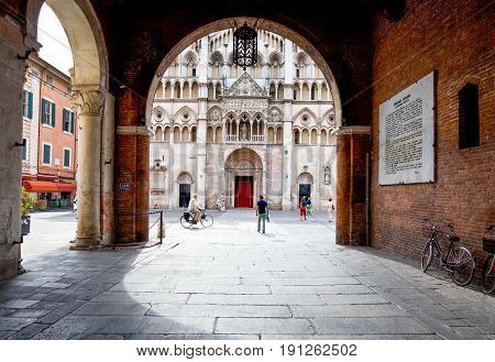 Ferrara Italy - July 21 2011: The facade of the Cathedral seen from the Ducale palace court