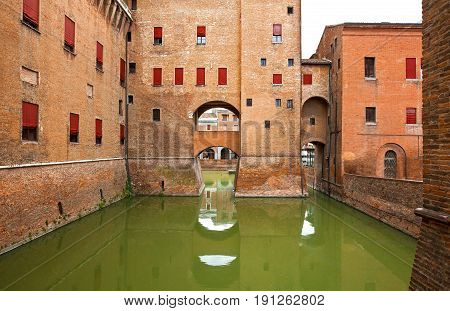 Ferrara Italy - July 21 2011: View of the moat of the Estense castle