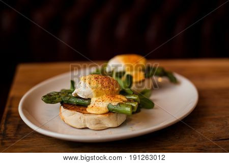Poached Eggs with Bechamel Sauce over Asparagus and Toasted Buns