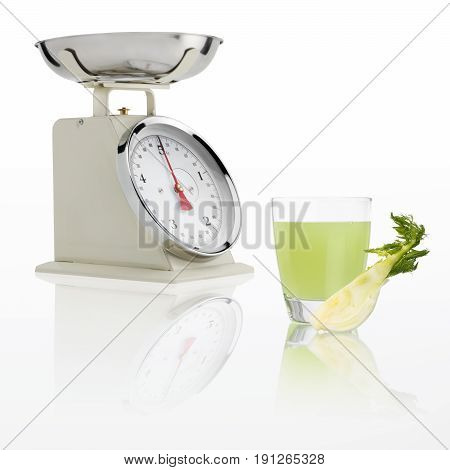 weight scale with fennel juice glass isolated on white background Balanced diet concept