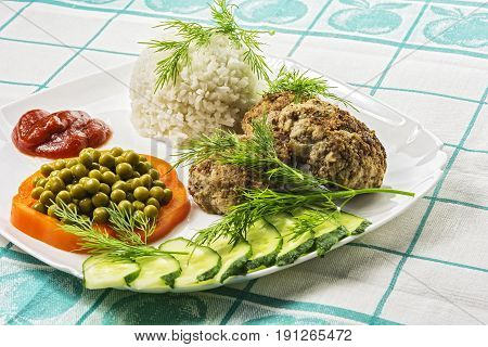 Home food. Cutlets with boiled rice and vegetables
