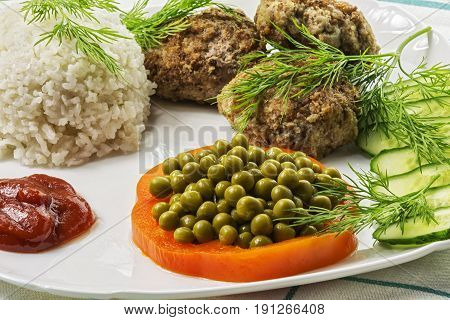Home food. Cutlet from minced meat with boiled rice and fresh vegetables