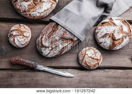 Delicious Fresh Bread On Wooden Background