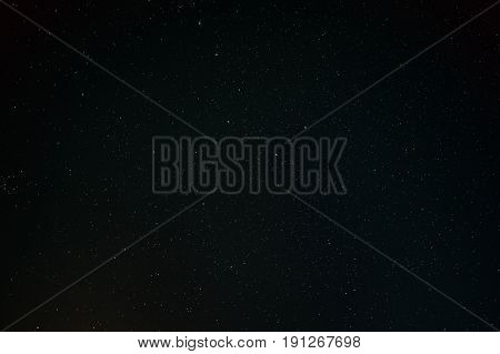 Black Dark Night Starry Sky Background. Night View Of Natural Glowing Stars. View From Eastern Europe At Spring Season.