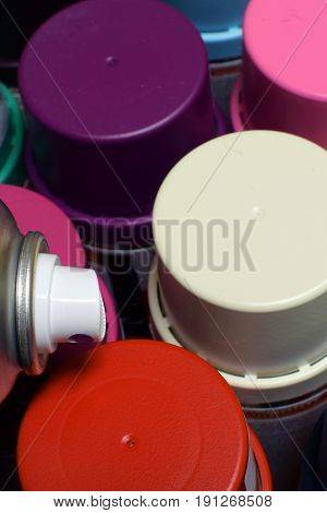 New Spray paint cans. Top view vertical image