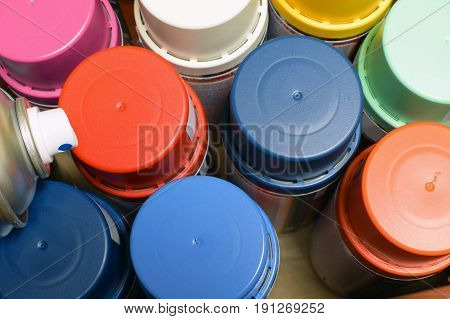 New spray paint cans. Top view image.