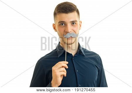 perky young guy with paper mustache isolated on white background