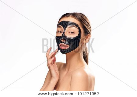Woman in cosmetic mask on isolated background portrait.