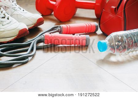 Sport equipments and bottle of water with copy space Sport girl accessories Healthy lifestyle
