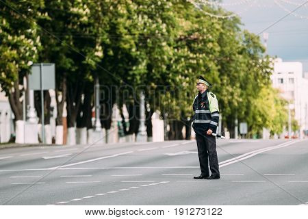 Gomel, Belarus - May 9, 2017: Traffic Road Police Officer Policeman Inspector Regulates Traffic At The Crossroads In Sovetskaya Street