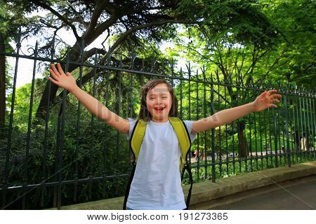 Down syndrome girl have fun in the park