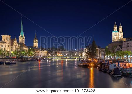 Panoramic view of historic Zurich city center with famous Fraumunster Church and river Limmat at Lake Zurich in twilight Canton of Zurich Switzerland.
