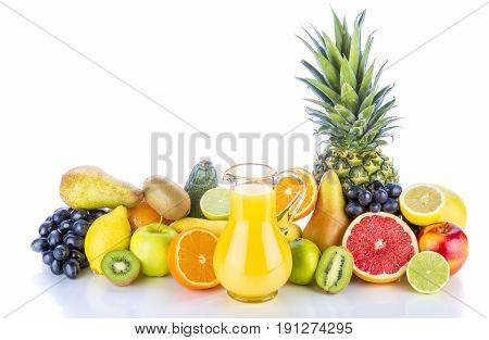 Assortment of exotic fruits and juice on white background.