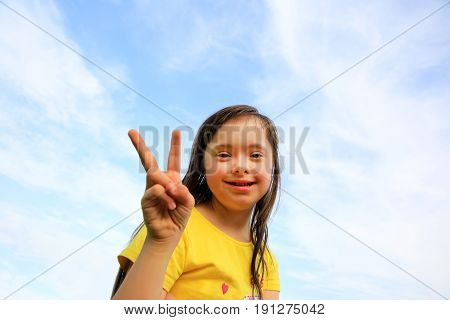 Young girl on the background of the sky