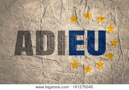 Politic situation between Britain and european union. Politic process named as brexit. French language word. Translation of the inscription goodbye. Yellow stars from EU flag. Concrete grunge texture