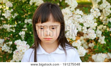 Down syndrome girl in the park .