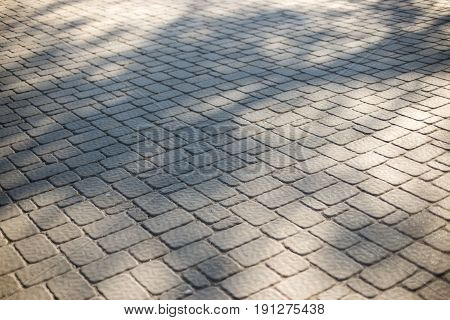 Background Of Tiles Paving. Beautiful Geometry With Shadow