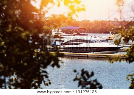 Expensive yacht for walks and excursions is worth a swim in the Moscow river. Concept travel in Moscow and St. Petersburg. Shine of the sun.