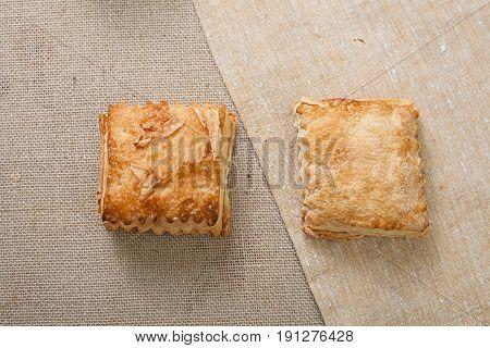 Fresh layered rolls with sugar coating. Top view. Warm fresh bread.
