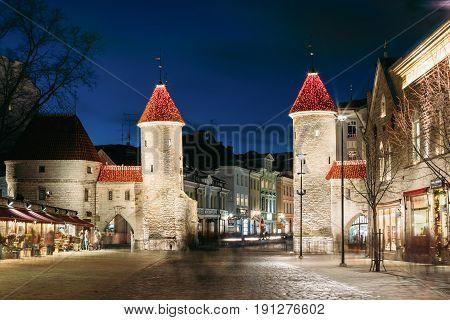 Tallinn, Estonia - December 5, 2016: Famous Landmark Viru Gate In Street Lighting At Evening Or Night Illumination. Christmas, Xmas, New Year Holiday Vacation In Old Town. Popular Touristic Place