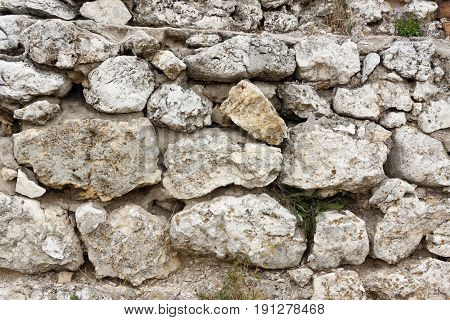 Detail of limestones wall. Beauty stony texture.