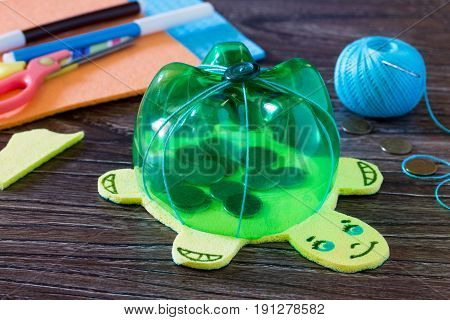 Children's Hand-made Article From A Plastic Bottle Piggy Bank For Money. Handmade. Project Of Childr
