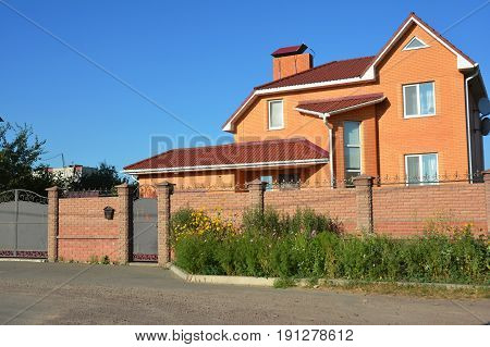 Building brick house construction with different types of attic roof design. Attic construction.