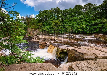 Richmond Falls at low water - The market town of Richmond is sited at the very edge of the North Yorkshire Dales on the banks of River Swale