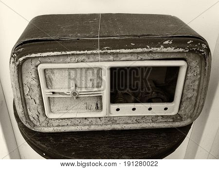 broken old wooden radio receiver with missing parts