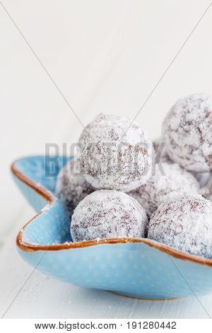 Chocolate Truffle With Sugar Powder On White