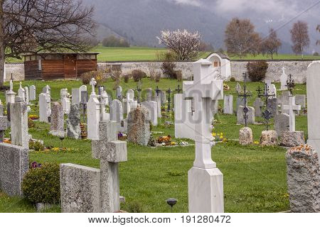 Old graveyard next to beauty church of St. John in Mustair UNESCO World Cultural Heritage Switzerland