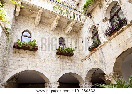 Courtyard of old tenement house - Trogir Croatia.