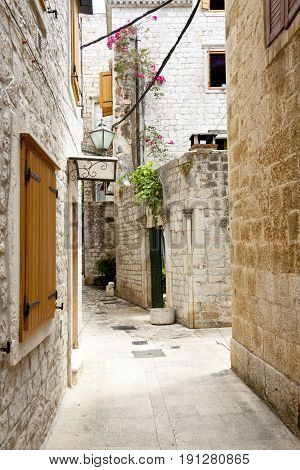 Beauty old narrow alley in UNESCO town Trogir - Croatia.