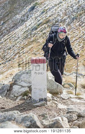 Active women on mountain path - Tatras Mountains. Polish National Park.