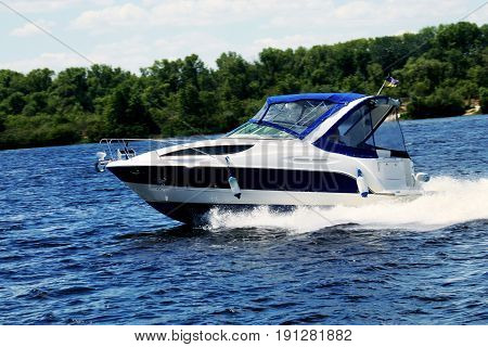 Motorboat on the river. Water transport - Boat.