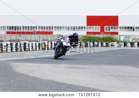 Motorcycle Practice Leaning Into A Fast Corner On Track