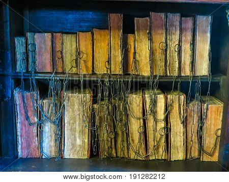 MANCHESTER, UNITED KINGDOM - NOVEMBER 4, 2013:   The ancient books chained in the Chetham's Library. Oldest free public reference library in the United Kingdom. Library since 1653 housing thousands of books and manuscripts