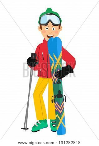 Happy skier wearing a red jacket, green hat and goggles holding skis and poles standing over white background