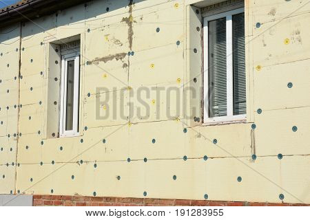 House wall insulation. Unfinished house with styrofoam insulation. Insulation House for energy saving.