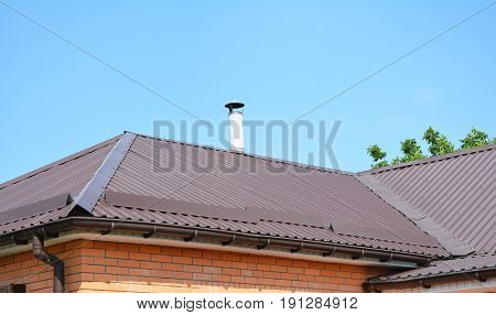 Metal roofing construction. Roof Repair with Rain Gutter and Problem Areas for House Metal Corner Roofing Construction Waterproofing.