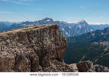 Mountain Ridge With Big Stone Among Barren Mountains In Italian Dolomites Alps In Summer Time
